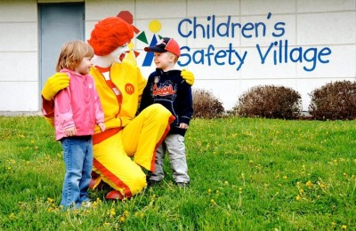 Ronald and kids near sign