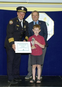Cambridge Fire Department Chief Main, Children's Safety Village Governing Committee Chair Lee Fitzpatrick and Carson McVey